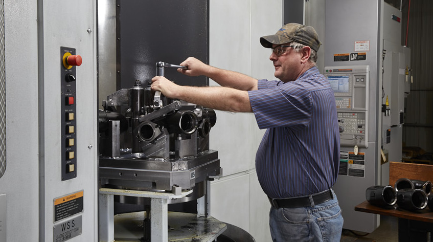 A member of our machining team at work.